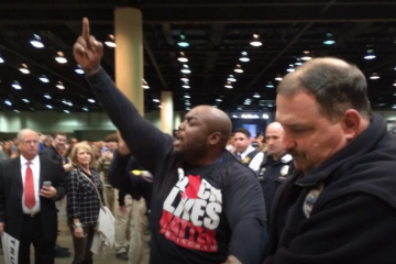 Black Lives Matter Supporter Removed From Donald Trump Rally In Alabama